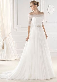 Dress Details Esien strapless wedding dress with sheer overlay and half sleeves Silhouette: A-Line Neckline: Strapless Waist: Empire Gown Length: Floor Train Length: Chapel Sleeve Style: Sheer Fabric: Tulle Special Features: Matching Veil Color: Ivory Size: 4 - 26 Price: $$