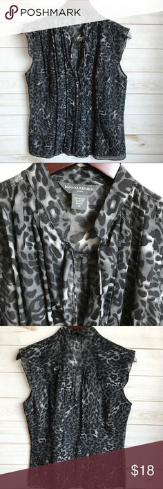 Banana Republic Medium blouse Banana Republic medium blouse. Black and gray animal print.  70% cotton 30% silk.  Low v neck with tie  front. Perfect with suit.  Smoke free home Banana Republic Tops Blouses