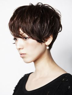 I love this. She looks like a real girl! Any one of us could rock this cut.
