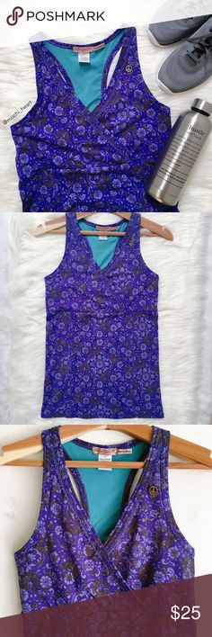 """Juicy Couture • floral peace performance tank Printed racerback tank by Juicy Couture in a beautiful purple mosaic pattern. Features overlapped v-neck front and lace detail. Cute workout top but does not have padding or support. Length is 25"""". Material is nylon/spandex. Please see photos #5-6 for minor flaw.  Please don't hesitate to ask questions. ❥ Juicy Couture Tops"""