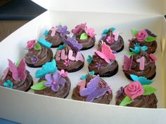 1st birthday cupcakes: butterfly & flower theme cupcakes for little girls birthday.