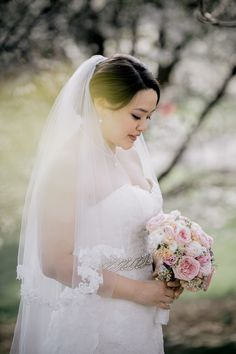 Hand-Sewn Lace Wedding Veil and Strapless A-Line Lace Wedding Dress | Dress – The White Gown | Bouquet – Cress Floral Decorators | Emily Wren Photography https://www.theknot.com/marketplace/emily-wren-photography-philadelphia-pa-595214 | Brooklyn Botanic Garden – Brooklyn, New York |