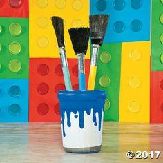 """Brush made from broom & pool noodle- paint bucket from trash can wrapped in paper with painted """"drip"""""""