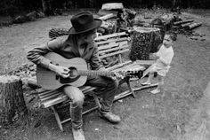 Bob Dylan plays for his son, Jesse. 1968