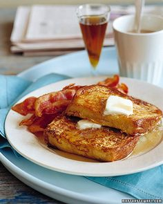Classic French Toast  6 large eggs  1 1/2 cups heavy cream, half-and-half, or milk  2 tablespoons pure vanilla extract  1/2 teaspoon ground cinnamon  Pinch of ground nutmeg  Pinch of salt  6 slices (1-inch-thick) bread, preferably day old  4 tablespoons unsalted butter  4 tablespoons vegetable oil  Pure maple syrup, for serving (optional)