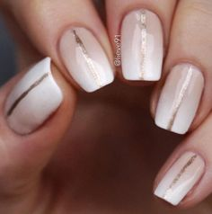 Very gentle ombre made of nude colors to white with a very mild and imperceptible transition. Gold line in the middle of the nail is responsible for luxurious look of manicure.