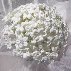 bridal bouquets Types of Flowers: Stephanotis with jewel pins.