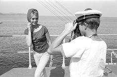 Brigitte being photographed by sailor onboard the escort 'Le Basque' at the invitation of the French Navy, photo by Jack Garofalo, Côte d'Azur, August 1958.