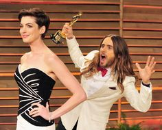 Anne Hathaway struck a pretty pose at the 2014 Vanity Fair Oscar Party, only to get photobombed by newly minted Academy Award winner Jared Leto and his shiny new piece of hardware.