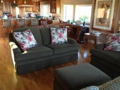Reupholstered 4 Cushion Love Seat and Ottoman with Skirt and Fabricated Decorative Pillows.