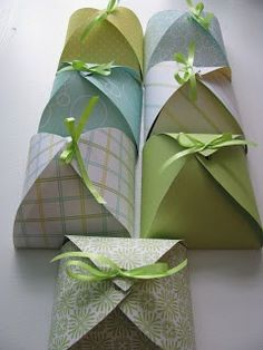 Gift box. Draw the pattern. Cut it out of card stock. Hole punch the corners. Tie closed with ribbon.
