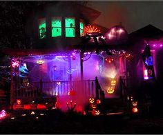This haunted house screams Halloween. We love the glowing colors that are illuminated from inside and out.