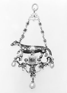 Ferret   Date: ca. 1600   Culture: probably Flemish or German   Medium: Gold, partly enameled, set with rubies and diamonds; pearls Dimensions: H. 3-1/2 x W. 1-7/8 in. (8.9 x 4.8 cm) Classification: Metalwork-Gold and Platinum Credit Line: Gift of George Blumenthal, 1941 Accession Number: 41.100.26