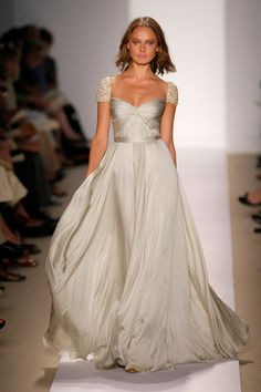 This dress would be gorgeous on a petite bride. I love the color.
