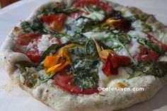 HERBED PIZZA WITH NASTURTIUM BLOOMS AND LEAVES