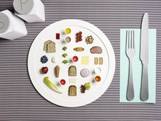 http://www.20minutos.es/noticia/1560905/0/diseno-fotografia/menu/deportistas-olimpicos/    ■El proyecto artístico 'My Day On A Plate' ('Mi día en un plato') muestra la dieta diaria de un triatleta, una corredora de 100 metros lisos, una lanzadora de martillo...   ■Los ingredientes y las cantidades se corresponden con el menú que el nutricionista Dan Bernardot elabora para los atletas.   ■Sarah Parker y Michael Bodiam presentan los alimentos sobre platos de gran tamaño.