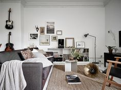 Black, grey, beige, white, walnut, and brass working in harmony. The key is monochrome + one accent color (gold).