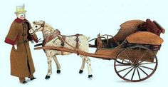 A Victorian Toy Horse driven Carriage with Driver. 1875.