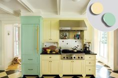 farmhouse style kitchen with pale yellow and green painted kitchen cabinets - dig that fridge!