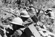 Four Italian soldiers taking aim in Ethiopia in 1935, during the Second Italo-Abyssinian War. Italian forces under Mussolini invaded and annexed Ethiopia, folding it into a colony named Italian East Africa along with Eritrea.