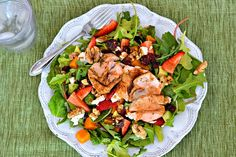 Mixed greens, arugula, strawberries, roasted butternut squash, walnuts, dried cranberries, avocado, honey goat cheese and salmon with homemade honey dijon balsamic vinaigrette