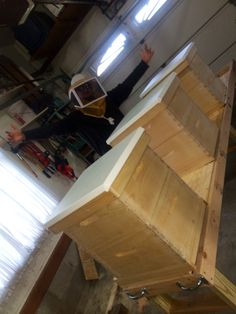 Brother with bee hives for honey and wax and earth
