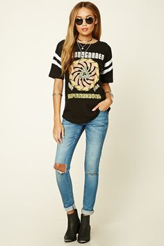 """A knit tour tee with an abstract """"Sound Garden Super Unknown Tour 1994"""" graphic on the front, contrast varsity-striped short sleeves, a tour list on the back, and a crew neckline."""