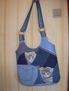 taske med katte, very nicely done