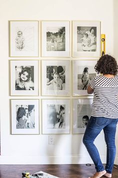 Hang the perfect grid style gallery wall in a cinch using this simple trick. Create a gallery wall without putting a million holes in the wall!
