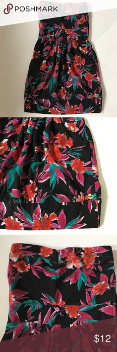 Billabong Tropical Floral Print Dress Strapless dress with pink, orange & teal floral print on a black background.  Peplum style with banded hem line.   Stretchy in back for a perfect fit.  Side pockets and zipper on side from waist up. Dress is made of 60%cotton; 40% polyester. Perfect with a pair of flip flops or sandals. Billabong Dresses Strapless