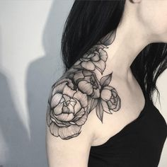rose shoulder and neck tattoo