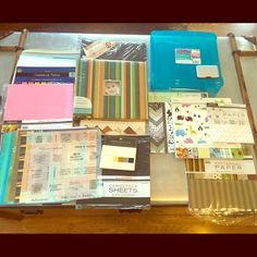 Huge scrapbook lot used and new (only half shown) Includes scrapbook box, mini card organizer, 2 brand new scrapbooks, all different sizes and colors of cardstock by: K&Co, S.E.I., Paper Paper, and other brands, a variety of stickers by: Making memories, Jolee, Marcela, Disney, Srickopatamis, Hallmark, Sanrio, decorative accents, page accents, metal frames, embellishments, rub on stickers/rub on transfers and letters, variety of letter stickers, 2 rolls of ribbon, plain envelops and cards…