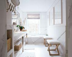 white modern bathroom with marble tiles floors