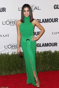 Eye popping! Wearing a green turtleneck dress with a cutaway design the dark haired beauty looked positively sensational