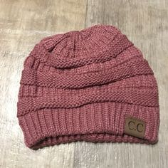 Mauve Slouchy Knit Beanie Keep warm while looking ADORABLESuper cute and popular beanie C.C beanieThick knit and super softPRICE IS FIRM CC Beanie Accessories Hats