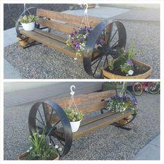 old steel wheel bench with cedar boards.