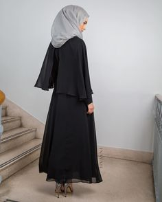 Channel elegance, style and sophistication with this classic maxi dress. Also available in colour Cinnamon and can be bought online and in-store.  Black Cape Maxi Dress Feather Grey Silk Chiffon Hijab  www.inayah.co
