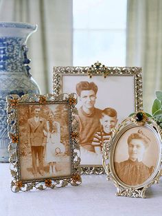 Create Vintage Charm  Family photos gain new prominence displayed in filigree metal frames embellished with vintage brooches. Thread thin satin ribbon through the open areas of the frame. (Thinking bigger frames would work better -- my grandmothers and great aunt had bigger brooches.)