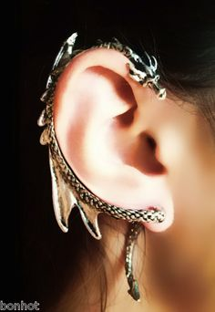 Game of Thrones inspired earring features a whispering dragon that enchantingly wraps around your ear.  The piece comes in two parts with the tail detaching to fit into a standard piercing as the head lays gently on top of the right ear. $20.