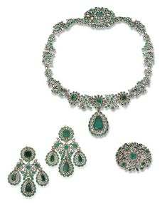 THE 'VIRREINA' SUITE  AN 18TH CENTURY EMERALD AND DIAMOND SUITE  Comprising a floral necklace with three central emerald and diamond clusters suspending a detachable pear-shaped emerald and diamond cluster, with matching cluster brooch; the earrings of girandole design, each cluster top suspending three detachable pear-shaped emerald and diamond clusters, six earring pendants attachable to the necklace, mounted in silver and gold, closed and open back settings, circa 1780