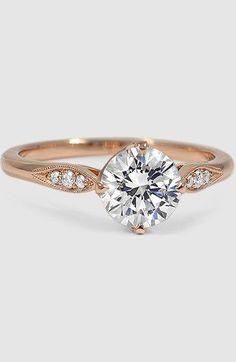 pavé set diamonds, milgrain detail, and a unique compass point setting