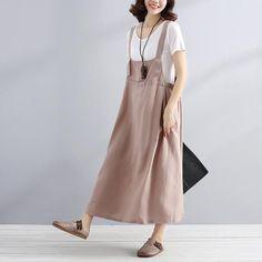 Material: Cotton Collar Type: Suspender SkirtClothing Placket: HedgingPattern: SolidStyle: CommuterSleeve: SleevelessPopular Elements: Buttons, LacingWaist: Nat