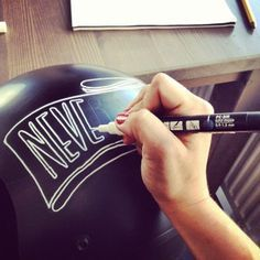 pinstriping and writing with pens on custom helmets