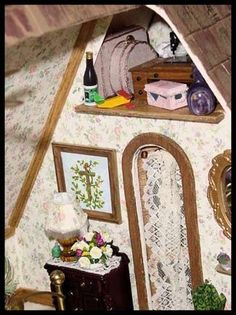 doll house by lone wolf mini creations of seeley lake Montana small storage area created above the doorway