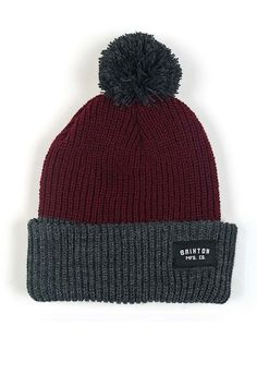 an adorable burgundy and gray beanie with a pom at the end. its always a good choice to put on a beanie like this one to keep your ears and hed warm and cozy.