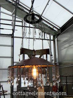 repurposed industrial lighting with chandelier prisms