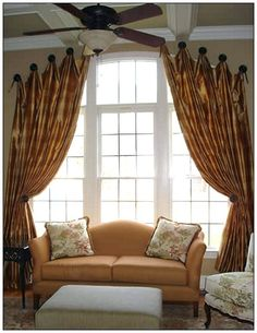Arched window draperies.