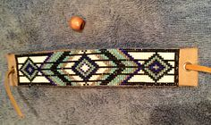 Ive hand made this bracelet on a bead loom with glass Delica Seed Beads - they catch the light and sparkle and shimmer. It features cool earthy