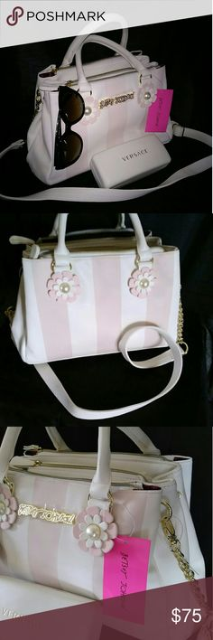 Betty Johnson  handbag Beautiful light pink and white soft leather with gold hardware and pearl decor. Has 4 compartment with zipper and 2 pockets in middle and a coin zipper in middle as well. The crossbody strap comes off as shown in 3rd picture. 14 inches in length 8 inches height 5 1/2. In width. Betty  Johnson  Bags Shoulder Bags