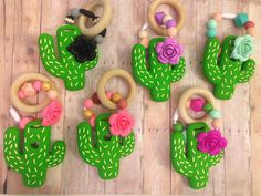 The Exclusive CACTUS teether is the absolute perfect companion to any on trend teething babe! Umbrella Tree Shop prides itself in offering unique quality products for you and your littles. We make safe, trendy, non-toxic teething accessories that parents and babies LOVE! - Handmade with Love in Phoenix - Chewable unique designs - 100% Certified food grade Silicone - Free of BPA, Phthalate, cadmium, lead, and metals - Easy to clean with mild soap and warm water!  SAFETY INFORMATION Dishwasher…